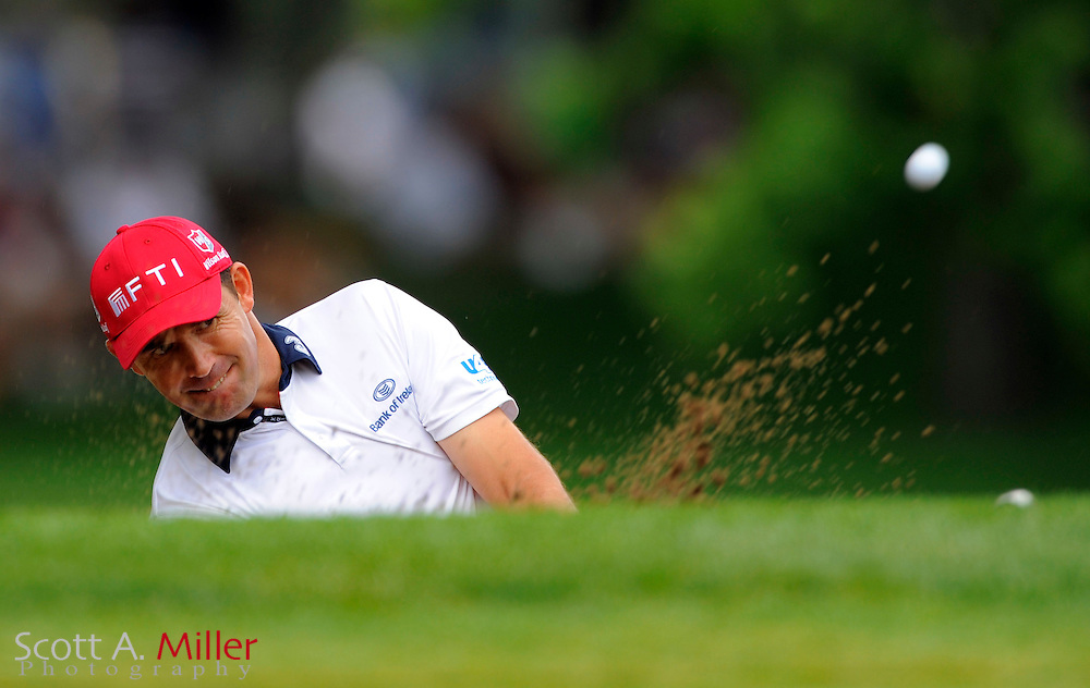 Aug 15, 2009; Chaska, MN, USA; Padraig Harrington (IRL) hits out of a greenside bunker on the 12th hole during the third round of the 2009 PGA Championship at Hazeltine National Golf Club.  ©2009 Scott A. Miller