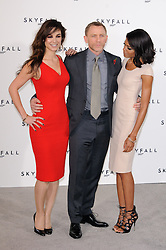 Berenice Marlohe, Daniel Craig and Naomie Harris pose for photographers at the photocall for the 23rd James Bond movie 'Skyfall', London, Thursday November 3, 2011. Photo By i-Images