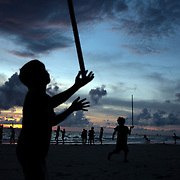 A beach scene at dusk as young children play balancing sticks at White Beach on October 2, 2008 in Boracay Island, the Philippines. Photo Tim Clayton..Asian tourists at White Beach, Boracay Island, the Philippines...The 4 km stretch of White beach on Boracay Island, the Philippines has been honoured as the best leisure destination in Asia beating popular destinations such as Bali in Indonesia and Sanya in China in a recent survey conducted by an International Travel Magazine with 2.2 million viewers taking part in the online poll...Last year, close to 600,000 visitors visited Boracay with South Korea providing 128,909 visitors followed by Japan, 35,294, USA, 13,362 and China 12,720...A popular destination for South Korean divers and honeymooners, Boracay is now attracting crowds of tourists from mainland China who are arriving in ever increasing numbers. In Asia, China has already overtaken Japan to become the largest source of outland travelers...Boracay's main attraction is 4 km of pristine powder fine white sand and the crystal clear azure water making it a popular destination for Scuba diving with nearly 20 dive centers along White beach. The stretch of shady palm trees separate the beach from the line of hotels, restaurants, bars and cafes. It's pulsating nightlife with the friendly locals make it increasingly popular with the asian tourists...The Boracay sailing boats provide endless tourist entertainment, particularly during the amazing sunsets when the silhouetted sails provide picture postcard scenes along the shoreline...Boracay Island is situated an hours flight from Manila and it's close proximity to South Korea, China, Taiwan and Japan means it is a growing destination for Asian tourists... By 2010, the island of Boracay expects to have 1,000,000 visitors.