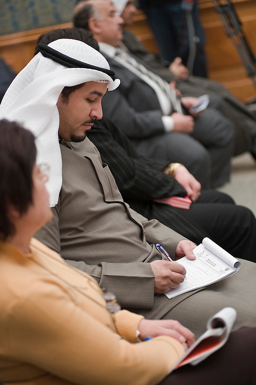 A journalist takes notes during a Jan. 24 seminar in Kuwait City organized by the Ministry of Information to highlight Kuwait's long tradition of democracy in the run up to parliamentary elections early next month. More than 400,000 Kuwaitis are scheduled to cast their ballots on Feb. 2, 2012 to choose from among some 320 candidates to elect a new 50-member National Assembly (parliament).