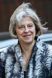 © Licensed to London News Pictures. 13/10/2015. London, UK. Home Secretary THERESA MAY leaving Downing Street after a cabinet meeting on Tuesday, 13 October 2015. Photo credit: Tolga Akmen/LNP