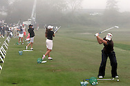 Golfers hit on the driving range during a delay due to fog during the first day of the US Women's Open Golf Championship at Newport Country Club in Newport Rhode Island, Thursday  29 June 2006