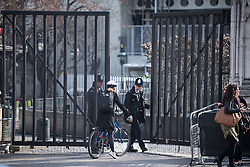© Licensed to London News Pictures. 22/03/2018. London, UK. Police guard the Carriage Gate entrance at the Houses of Parliament in Westminster, London on the one year anniversary of the Westminster Bridge Terror attack in which lone terrorist killed 5 people and injured several more, in an attack using a car and a knife. The attacker, 52-year-old Briton Khalid Masood, managed to gain entry to the grounds of the Houses of Parliament and killed police officer Keith Palmer. Photo credit: Ben Cawthra/LNP