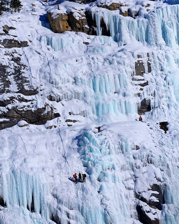 Ice climbers on the Lower Weeping Wall along the Icefields Parkway, Banff National Park, Canadian Rockies, Alberta, Canada