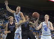 Nov 15, 2017; Los Angeles, CA, USA; UCLA Bruins forward Alex Olesinski (0) and Central Arkansas Bears forward Ethan Lee (2) battle for the ball during a NCAA basketball at Pauley Pavilion.