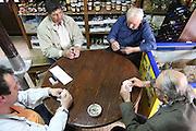 Greece, Macedonia, Prespa lakes, Psarades village men playing cards at leisure