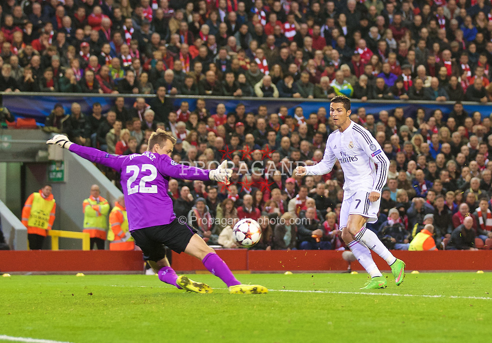 LIVERPOOL, ENGLAND - Wednesday, October 22, 2014: Liverpool's goalkeeper Simon Mignolet saves a shot from Real Madrid CF's Cristiano Ronaldo during the UEFA Champions League Group B match at Anfield. (Pic by David Rawcliffe/Propaganda)
