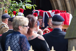 © Licensed to London News Pictures . 12/07/2013 . Bury , UK . Pall bearers carry Lee Rigby 's coffin away from the church after the service . The funeral for Fusilier Lee Rigby at Bury Parish Church in Bury town centre today (Friday 12th July 2013) , watched by 100s of people . Fusilier Rigby's coffin was held in Bury Parish Church overnight , watched over by an honour guard of soldiers from the 2nd Battalion Royal Regiment of Fusiliers ( 2RRF ) . Rigby was brutally murdered in Woolwich , London on 22nd May 2013 . Photo credit : Joel Goodman/LNP