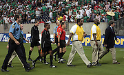 09 JUL 2009:  Officials are escorted off the field during a soccer game between Mexico and Panama July 09, 2009 at Reliant Stadium in Houston, Texas.