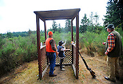 Ken Welsh, left, Western Washington Pheasant Releasers volunteer, and Paul Hunter, right, watch Sage Burgamy, 9, fire a shotgun Aug. 13 during the Youth Shotgun Shoot at the Lewis Main Skeet Range.