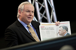 © Licensed to London News Pictures. 02/10/2012. Manchester, UK . Sky News' Adam Boulton reviewing the papers with Ed Balls on the page . Labour Party Conference Day 3 at Manchester Central . Photo credit : Joel Goodman/LNP