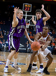 Virginia guard Sean Singletary (44) passes around the defense of Northwestern guard-forward Jeff Ryan (5) and Northwestern forward-center Nikola Baran (11).  The Virginia Cavaliers men's basketball team faced the Northwestern Wildcats at John Paul Jones Arena in Charlottesville, VA on November 27, 2007.