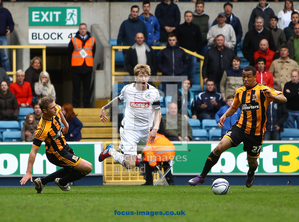 Picture by John Rainford/Focus Images Ltd. 07506 538356.07/04/12.Andy Keogh of Millwall is brought down in the box by Liam Cooper of Hull City during the Npower Championship match at The Den stadium, London.