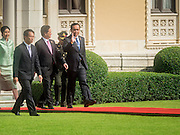 23 JULY 2015 - BANGKOK, THAILAND: NGUYEN TAN DUNG (left), Prime Minister of Vietnam,  and PRAYUTH CHAN-O-CHA, Prime Minister of Thailand,  walk across the grounds at Government House in Bangkok. The Vietnamese Prime Minister and his wife came to Bangkok for the 3rd Thailand - Vietnam Joint Cabinet Retreat. The Thai and Vietnamese Prime Minister discussed issues of mutual interest.      PHOTO BY JACK KURTZ