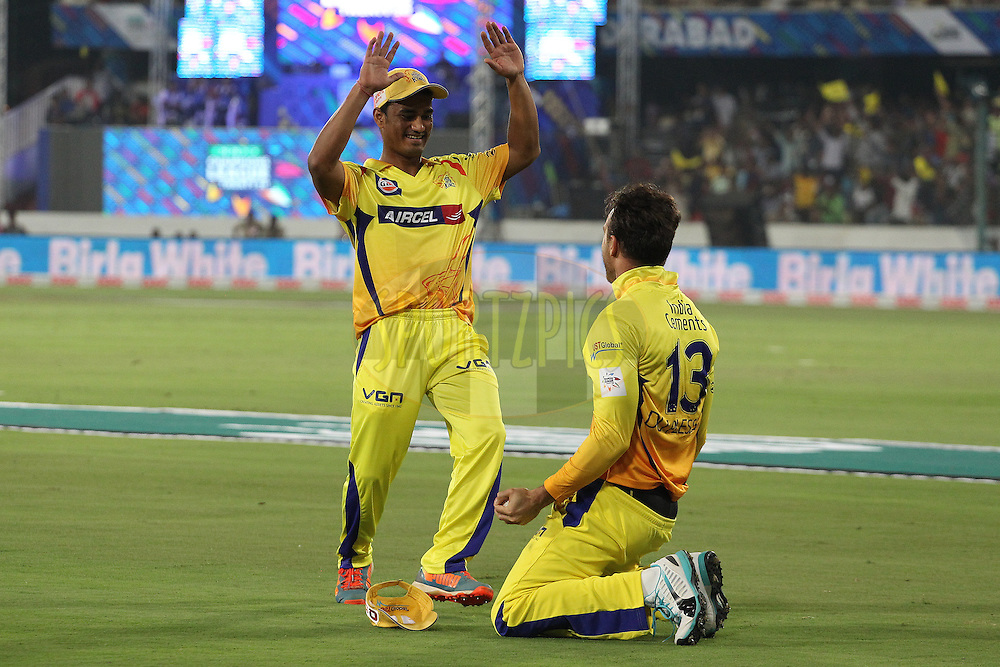 NEGI of the Chennai Superkings congratulates Francois Du PLESSIS of the Chennai Superkings on taking the catch to dismiss Manan VOHRA of the Kings XI Punjab  during the second semi final match of the Oppo Champions League Twenty20 between the Kings XI Punjab and the Chennai Superkings held at the Rajiv Gandhi Cricket Stadium, Hyderabad, India on the 2nd October 2014<br /> <br /> Photo by:  Ron Gaunt / Sportzpics/ CLT20<br /> <br /> <br /> Image use is subject to the terms and conditions as laid out by the BCCI/ CLT20.  The terms and conditions can be downloaded here:<br /> <br /> http://sportzpics.photoshelter.com/gallery/CLT20-Image-Terms-and-Conditions-2014/G0000IfNJn535VPU/C0000QhhKadWcjYs