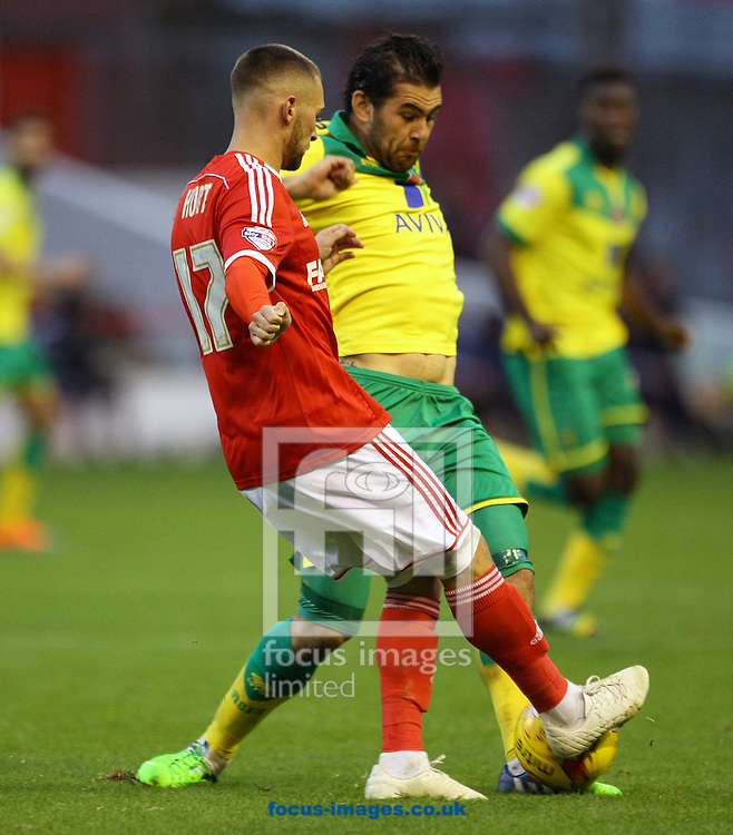 Bradley Johnson of Norwich and Jack Hunt of Nottingham Forest in action during the Sky Bet Championship match at the City Ground, Nottingham<br /> Picture by Paul Chesterton/Focus Images Ltd +44 7904 640267<br /> 08/11/2014