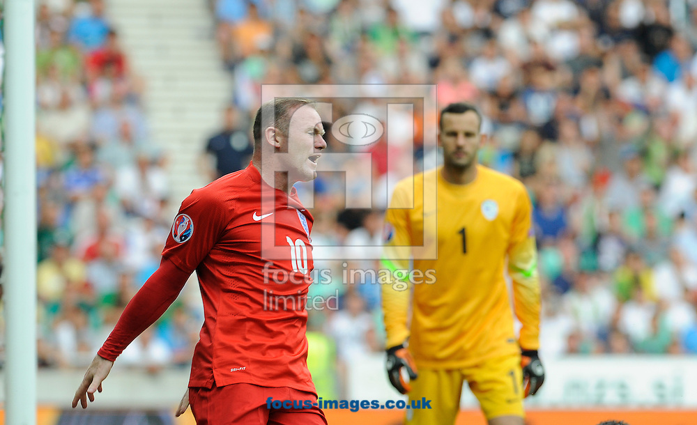 Wayne Rooney of England reacts during the UEFA Euro 2016 Qualifying match at Stozice Stadium, Ljubljana<br /> Picture by Stefano Gnech/Focus Images Ltd +39 333 1641678<br /> 14/06/2015