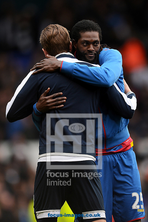 Emmanuel Adebayor of Crystal Palace greets Harry Kane of Tottenham Hotspur pre-match during the FA Cup match between Tottenham Hotspur and Crystal Palace at White Hart Lane, London<br /> Picture by Richard Blaxall/Focus Images Ltd +44 7853 364624<br /> 21/02/2016