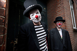 © licensed to London News Pictures. London, UK 05/02/12. Clowns are posing before the annual clown service in memory of Grimaldi at the Holy Trinity Church in Dalston, London. Photo credit: Tolga Akmen/LNP