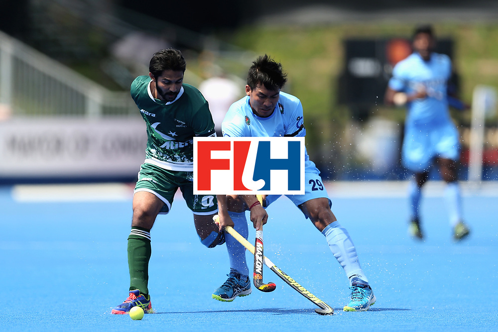 LONDON, ENGLAND - JUNE 18: Abdul Khan of Pakistan battles for the ball with Chinglensana Kangujam of India during the Hero Hockey World League Semi Final match between Pakistan and India at Lee Valley Hockey and Tennis Centre on June 18, 2017 in London, England.  (Photo by Alex Morton/Getty Images)