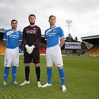 St Johnstone midfielders Paul Paton and Liam Craig pictured with keeper Zander Clark wearing the new home strip for the 2016-17<br />