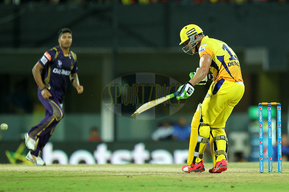Faf Du Plesssis of Chennai Super Kings hurt by Umesh Yadav's bouncer during match 28 of the Pepsi IPL 2015 (Indian Premier League) between The Chennai Superkings and The Kolkata Knight Riders held at the M. A. Chidambaram Stadium, Chennai Stadium in Chennai, India on the 28th April 2015.Photo by:  Prashant Bhoot / SPORTZPICS / IPL