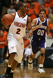 Virginia guard J.R. Reynolds (2) dribbles the basketball up court against Northwestern.  Reynolds played 37 minutes and had 13 points as the Hoos beat the Wildcats for the second year in a row -- the score was 72-57...The Virginia Cavaliers Men's Basketball team defeated the Northwestern Wildcats 72-57 in the ACC/BigTen Challenge at University Hall in Charlottesville, VA on November 30, 2005..