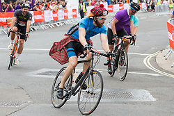 London, UK. 4 August, 2019. A rider wearing a tartan cap approaches the finish for the Prudential RideLondon-Surrey 100 and 46 events in the Mall. Both events take place on traffic-free roads in London and Surrey, with the 100 event featuring leg-testing climbs on a route made famous by the London 2012 Olympics.