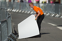 A marshall picks up a hoarding from the course of The London-Surrey 100 at Prudential RideLondon on Sunday 30th July 2017<br /> <br /> Photo: Joe Toth/Silverhub for Prudential RideLondon<br /> <br /> Prudential RideLondon is the world's greatest festival of cycling, involving 100,000+ cyclists – from Olympic champions to a free family fun ride - riding in events over closed roads in London and Surrey over the weekend of 28th to 30th July 2017. <br /> <br /> See www.PrudentialRideLondon.co.uk for more.<br /> <br /> For further information: media@londonmarathonevents.co.uk