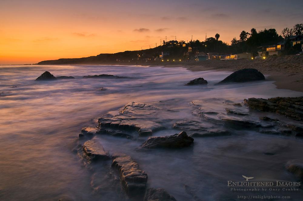 Waves on coastal rocks at sunset, Crystal Cove State Park Historic District beach, Corona del Mar, Newport Beach, California