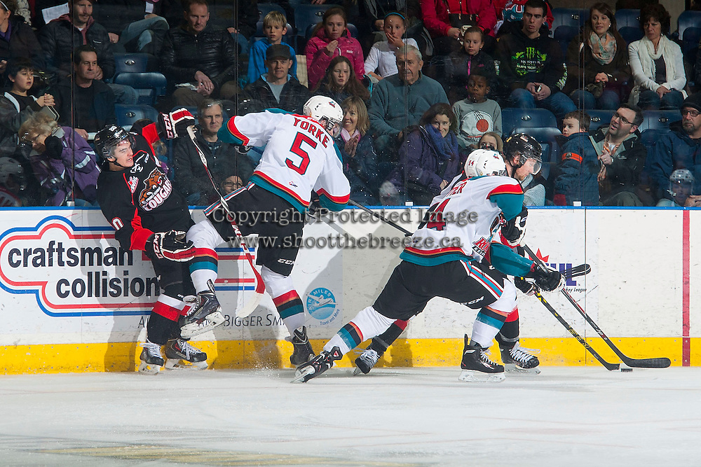 KELOWNA, CANADA - DECEMBER 30: Haydn Hopkins #20 of Prince George Cougars is checked by Dalton Yorke #5 of Kelowna Rockets at the boards on December 30, 2014 at Prospera Place in Kelowna, British Columbia, Canada.  (Photo by Marissa Baecker/Shoot the Breeze)  *** Local Caption *** Dalton Yorke; Haydn Hopkins;