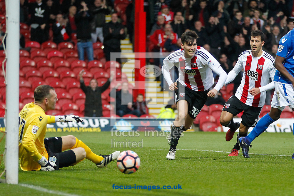 Tom Field of Brentford celebrates scoring his first goal for the club and his team's second of the game during the FA Cup 3rd round match between  Brentford and Eastleigh FC  at Griffin Park, London<br /> Picture by Mark D Fuller/Focus Images Ltd +44 7774 216216<br /> 07/01/2017