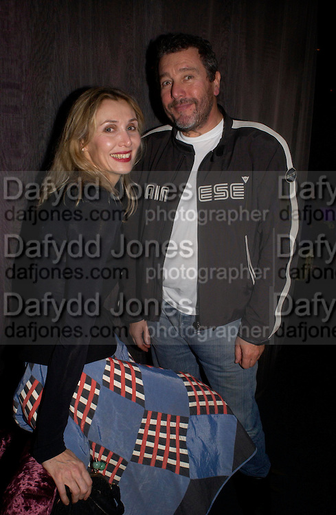 Allegra Hicks and Phillipe Starck. party given by Daphne Guinness for Christian Louboutin  after the opening of his new shopt.  Baglione Hotel. 16 March 2004.  ONE TIME USE ONLY - DO NOT ARCHIVE  © Copyright Photograph by Dafydd Jones 66 Stockwell Park Rd. London SW9 0DA Tel 020 7733 0108 www.dafjones.com