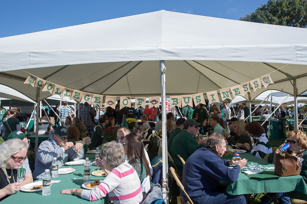 College of Business alumni eat and socialize at their homecoming tailgating event on October 10, 2015 at Ohio University's Tailgreat Park. Photo by Emily Matthews