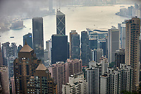 View to the harbour and commercial district from Victoria Peak with low lying cloud and pollution haze, Hong Kong   Photo: Peter Llewellyn
