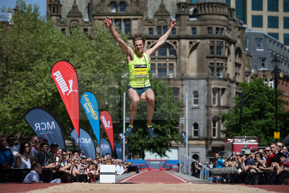© Licensed to London News Pictures . 17/05/2014 . Manchester , UK . CHRISTOPHER TOMLINSON . The Great City Games in Manchester , with athletics on a track along Deansgate and Pole Vault and Long Jump in Albert Square . Photo credit : Joel Goodman/LNP