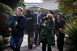 © Licensed to London News Pictures . 19/11/2014 . Kent , UK . UKIP candidate MARK RECKLESS (centre) arrives at Hoo Marina Park in Rochester , surrounded by media , to canvas votes . The Rochester and Strood by-election campaign following the defection of sitting MP Mark Reckless from Conservative to UKIP . Photo credit : Joel Goodman/LNP