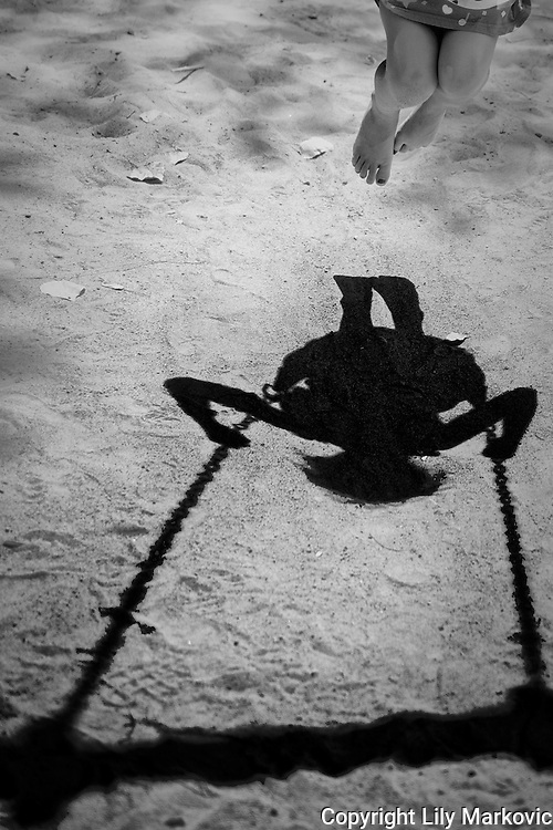 Shadow a Girl on a Swing