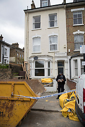 © Licensed to London News Pictures.19/03/2017.London, UK. A police forensics officer stands outside a property where hammer was found in a builder's bag of sand round the corner from Wilberforce Road where one baby has been found dead and another seriously injured in Finsbury Park. Police have named  Bidhya Sagar Das who lives at the property and is wanted in connection with the death.  Photo credit: Peter Macdiarmid/LNP