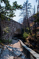 During the smoky, dramatic fire season of 2017, a visit to a recently burned region of Glacier National Park reveals a landscape still recovering. The forest and banks of Baring Creek and Sunrift Gorge were ravaged by wildfire during the Reynolds Creek Fire in 2015. During this short walk along the water through skeleton trees the air was thick with smoke from several fires burning throughout Glacier National Park.