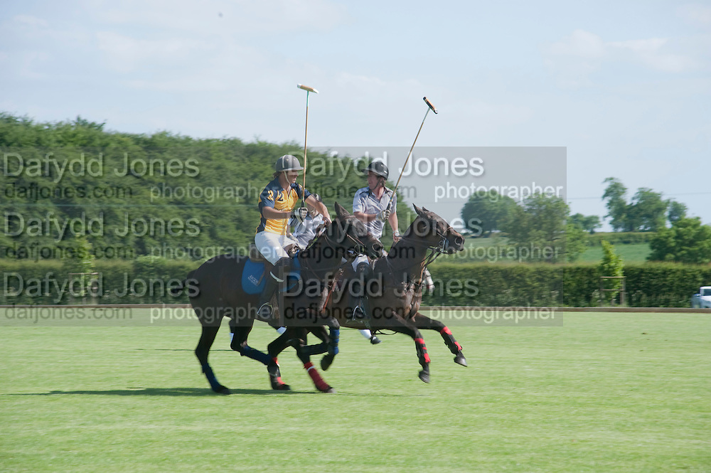 POLO MATCH BETWEEN HALCYON GALLERY TEAM AND LOVELOCKS, The Dalwhinnie Crook  charity Polo match  at Longdole  Polo Club, Birdlip  hosted by the Halcyon Gallery. . 12 June 2010. -DO NOT ARCHIVE-© Copyright Photograph by Dafydd Jones. 248 Clapham Rd. London SW9 0PZ. Tel 0207 820 0771. www.dafjones.com.