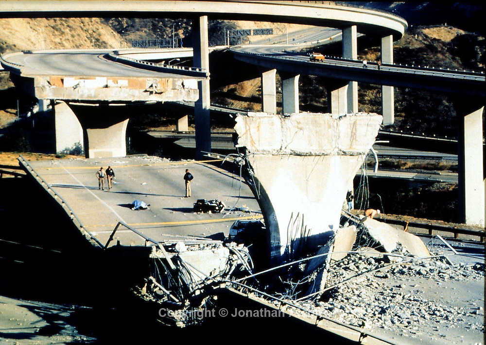 Jan 17, 1994 - Northridge, California, U.S. - Freeway collapses, kills a cop. CHIPS motorcycle police officer dies as bridge caves in below him. 4:30:55 AM PST falling on Martin Luther King Day a Magnitude 6.7 earthquake hit LA area. Duration 15 seconds. Number of injured 9,000+, Deaths 51. Damage 4 Billion. 25,000 dwellings uninhabitable. Portions of 11 major Los Angeles area roads had to close. 22,000 people were left homeless. The costliest earthquake disaster in U.S. history. This image was the front page photo on the following day's LA Times Earthquake Edition