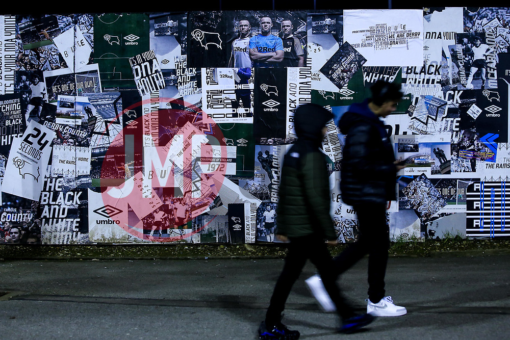 Derby County fans walk past a poster of Wayne Rooney of Derby County outside Pride Park Stadium - Mandatory by-line: Robbie Stephenson/JMP - 02/01/2020 - FOOTBALL - Pride Park Stadium - Derby, England - Derby County v Barnsley - Sky Bet Championship
