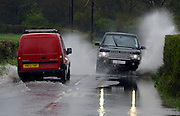 © Licensed to London News Pictures. 29/04/2012. Stapleford, UK . Cars drive through flooding in Tawney, Stapleford, Essex. Torrential rain has lead to flooding in parts of the country today 29 April 2012. Photo credit : Stephen Simpson/LNP
