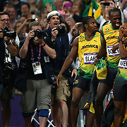 Usain Bolt, Jamaica, wins the Men's 200m Final and celebrates with fellow Jamaicans Johan Blake and Warren Weir who finished second and third at the Olympic Stadium, Olympic Park, during the London 2012 Olympic games. London, UK. 9th August 2012. Photo Tim Clayton