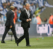 Steve McClaren, manager of Derby County walks out onto the Wembley pitch in the rain prior to the Sky Bet Championship Play Off final at Wembley Stadium, London<br /> Picture by Andrew Tobin/Focus Images Ltd +44 7710 761829<br /> 24/05/2014