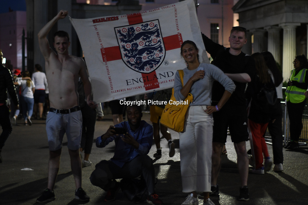 England fans holding a English football flag proudly even England loss to Croatia the 2018 FIFA World Cup semi-finals in Moscow outside Hype park on 11 July 2018.
