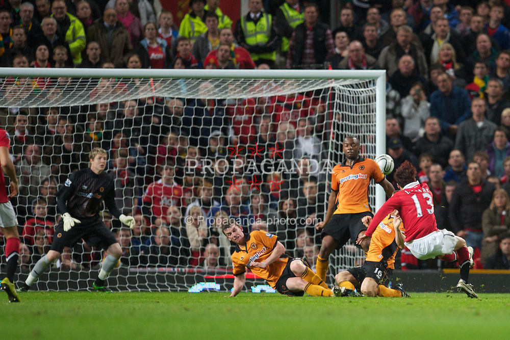 MANCHESTER, ENGLAND - Tuesday, October 26, 2010: Manchester United's Ji-Sung Park scores the second goal against Wolverhampton Wanderers during the Football League Cup 4th Round match at Old Trafford. (Pic by: David Rawcliffe/Propaganda)