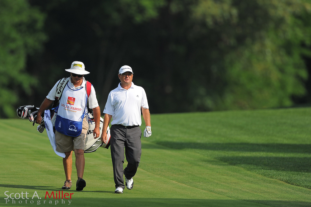 Gavin Coles and his caddie during the third round of the Wells Fargo Championship at the Quail Hollow Club on May 5, 2012 in Charlotte, N.C. ..©2012 Scott A. Miller.