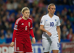 CARDIFF, WALES - Tuesday, August 21, 2014: Wales' Michelle Green and England's Toni Duggan during the FIFA Women's World Cup Canada 2015 Qualifying Group 6 match at the Cardiff City Stadium. (Pic by Ian Cook/Propaganda)